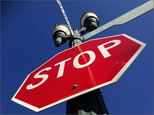 Stop and think at stop sign.